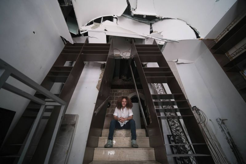 Aline Kamakian, inside her damaged restaurant after the explosions.  Photo by João Sousa
